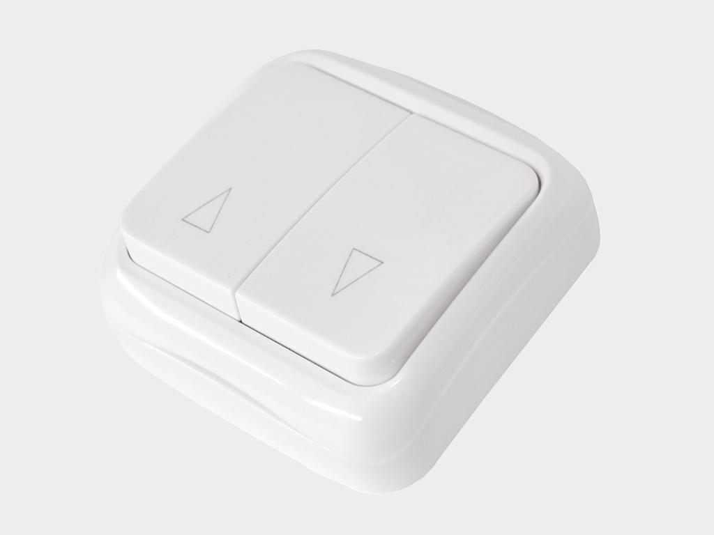 <p>Клaвишный двухпозиционный выключатель накладной для управления приводом в обе стороны движения</p>